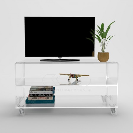 Muebles y Carritos TV de metacrilato transparente con estantes.